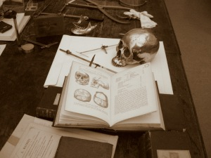 Rolleston's skull measuring instruments and the copy of Darwin's Origin of the Species given to him by the author.